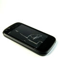 Broken smartphone. Front screen broken, on white background Royalty Free Stock Images