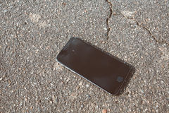 Broken smartphone. Smartphone on hard floor with cracked screen stock images