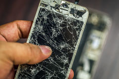 A broken smartphone. A broken and not function smartphone stock image