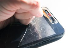 Punch in the screen of the phone. Broken smartphone. Punch on the screen Stock Images