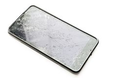 Broken smartphone screen. Broken smartphone screen on white background. Selective focus royalty free stock photography