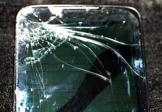 Broken smartphone screen. Phone screen broken in cracks. Broken smartphone screen. Phone screen broken in cracks stock image