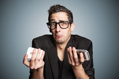 Broken smartphone. Young businessman with broken smartphone stock photo