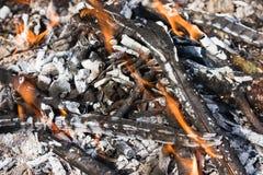 Broken smoldering bonfire. Scattered broken smoldering bonfire with flame top horizontal view stock photos