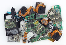 Broken spare parts from  photo cameras. VILNIUS, LITHUANIA - MARCH 23, 2016:  Broken spare parts from Sony and Panasonic brands  photo cameras  lie on white Stock Images