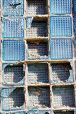 Broken square of glass in a window box. Broken glass square boxes in the blue box royalty free stock photo