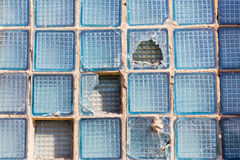 Broken square of glass in a window box. Broken glass square boxes in the blue box stock photos