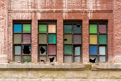Broken Stained Glass Windows on Old Abandoned Brick Building Royalty Free Stock Photos