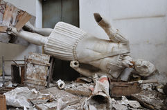 Broken statue gigantic figure of ancient god Royalty Free Stock Photo
