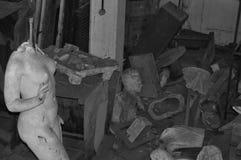Broken statue of nude female figure. ATHENS - JANUARY 15: Broken statue of nude female figure among vandalized sculptures in the abandoned studio of artist Stock Photo