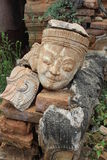 Broken statue. Ruins of statue with smiling face Royalty Free Stock Photos