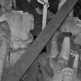 Broken statues among debris Stock Image