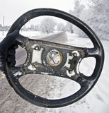Broken Steering Wheel. Steering Wheel From The Scene Of Accident, Road In Background Royalty Free Stock Images
