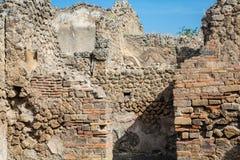Broken stone and brick walls in Pompeii. Old broken brick and stone walls in the ancient lost city of Pompeii royalty free stock photo