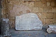 Broken stone cross found in Acropolis of Ialysos near the temple. royalty free stock photo