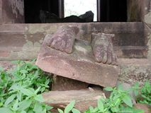Broken stone feet. The broken stone feet from a staue in Ankor Wat, Cambodia Stock Photo