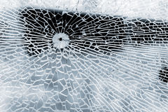 Broken strained glass with bullet hole. And craks. Close-up background photo texture Stock Photography