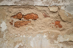 Broken Stucco Colonial Stucco Wall in Asia with Slight Brick. View of a Broken Stucco Colonial Stucco Wall in Asia with Slight Brick showing through the beige Royalty Free Stock Photos