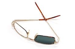 Broken sun glasses Royalty Free Stock Image