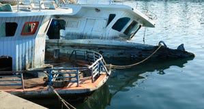 Broken sunken pleasure boat in the water, Royalty Free Stock Photos