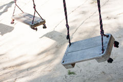 Broken swing Stock Images