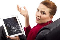 Broken Tablet. Complaining about a broken tablet screen stock photo