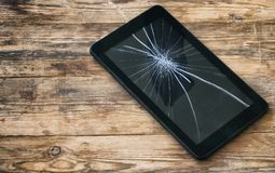 Broken tablet computer, cracked glass display stock photos