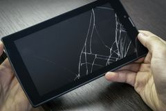 Broken tablet screen. Cracks on the tablet royalty free stock photography