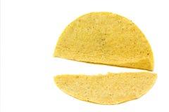 Broken Taco Shell. Isolated broken yellow corn tortilla taco shell on a white background Stock Photography