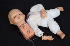 Broken talking doll Stock Photos
