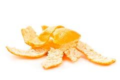 Broken tangerine peel. On white background Stock Photography