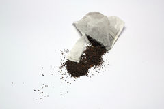 Broken tea bag on a white background. Royalty Free Stock Images