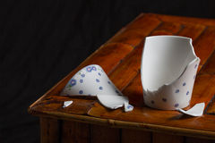 Broken tea cup Stock Images