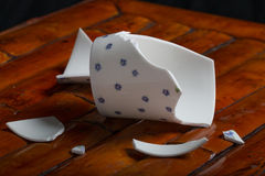 Broken tea cup Royalty Free Stock Image