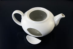 Broken teapot Stock Image