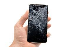 Broken telefon i en hand Arkivbilder