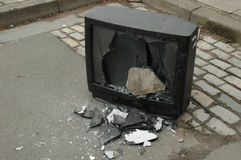 Broken television. A broken television, that has had it's screen smashed in with a concrete brick Stock Photo
