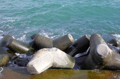 Broken tetrapod on breakwater Royalty Free Stock Photography