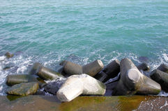 Broken tetrapod on breakwater Royalty Free Stock Image