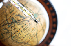 Broken thermometer with vintage globe background Stock Photo