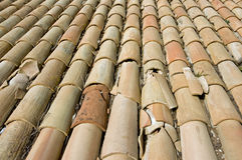Broken tiles. Spanish roof tiles with broken tiles royalty free stock image