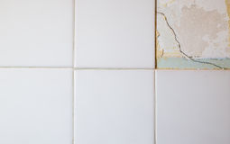 Broken Tiles. Close Up texture of white broken tiles on wall Royalty Free Stock Photography