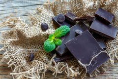 Broken tiles of dark chocolate and mint green. Royalty Free Stock Image