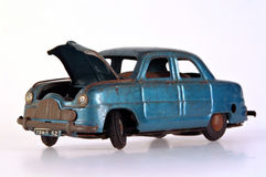 Broken Tin Toy Car. A battered and broken tin toy car, with bonnet open Royalty Free Stock Photography