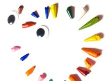 Broken tips of colored pencils. Arranged in circle, radial. Face royalty free stock images