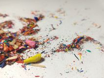 Broken tips of colored pencils. Shavings. royalty free stock photo