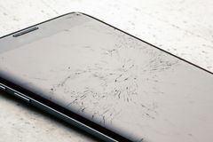 Broken touch screen of a black smartphone.  royalty free stock photography