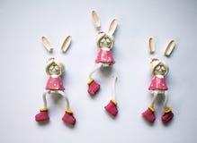 Broken toys on white background. Flat image of broken rabbit with closed eyes. Ceramic figurine broken. Concept for broken child, childhood trauma, pedophilia royalty free stock photos
