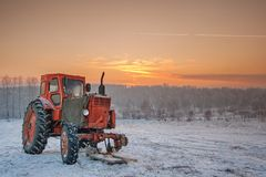 A broken tractor on the field Stock Photos