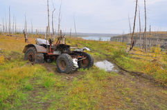 Broken tractor in the tundra. Stock Photos